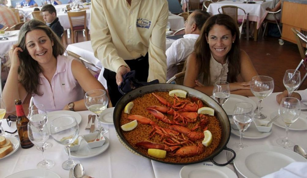 file-photo-of-a-waiter-serving-a-traditional-paella-at-a-beach-side-restaurant-in-valencia